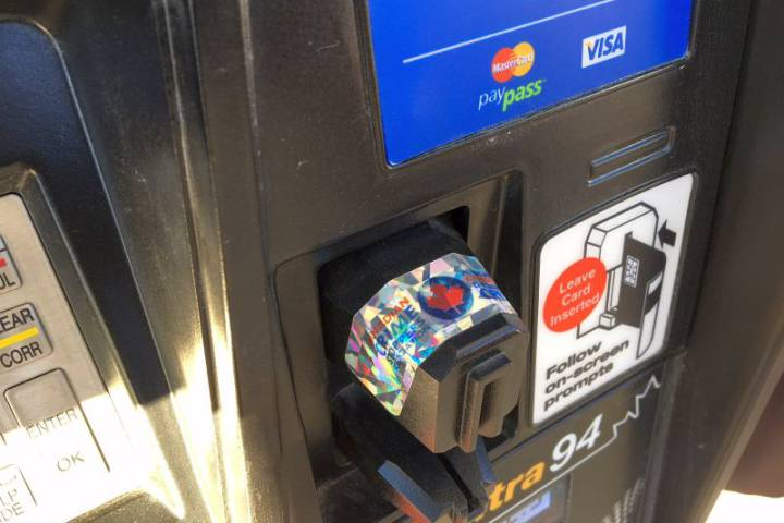 Holographic decals at Calgary gas stations warn of potential fraud, having rolled them out in Ontario last year